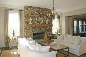 Airy Living Room with Bold Stacked Stone Fireplace