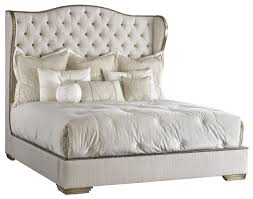 Bed with tufted headboard in a elegant platinum linen