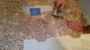 how to install stone tile on a shower floor