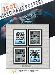 set of four blue xbox posters for