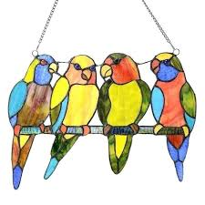 e stained glass birds on a wire