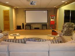 rectangle white screen on cream wall combined by grey velvet sofa