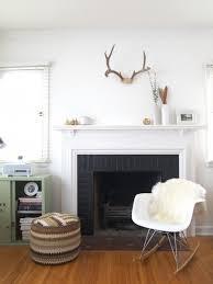 Minimalist fireplace decor for a modern Scandinavian home.