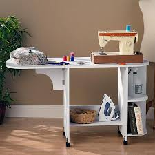 southern enterprises expandable rolling sewing table craft station white