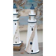 coastal living white wooden lighthouse