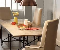 large room lighting. go big with large copper finish pendant lights over a wood top table room lighting