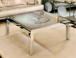 steel and glass furniture. luxury italian coffee table shown in a glass top with plaster rosettes on undertop lacquered steel and furniture