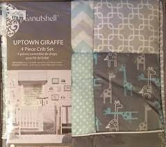 uptown giraffe fitted crib toddler grey