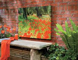 here s how to hang outdoor wall art in four easy steps