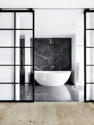 black framed sliding glass doors for a bathroom