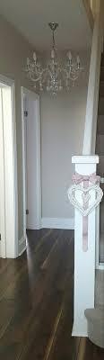 simple bannister dressing. Dulux Egyptian cotton walls.white satin  woodwork.dark walnut flooring