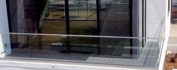 frameless glass railing system installed on residential balcony