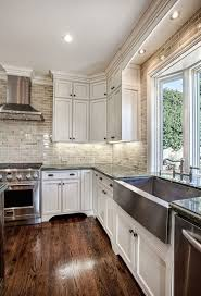 kitchens with white cabinets and dark floors7 kitchens