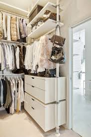 Walk in closet created by IKEA Stolmen system