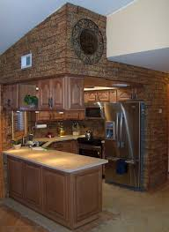 unique kitchen design for small spaces with brown interior color paint decor plus faux stone wall panels and backsplash combined with wooden cabinet and