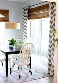 hi sugarplum bright and cheery breakfast room makeover with woven wood shades and chevron printed