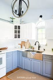this diy kitchen cabinet painting project was a relatively simple and budget friendly way to completely refresh the entire room
