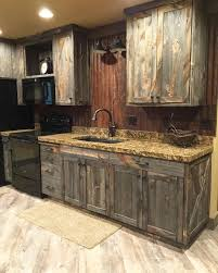 rustic kitchen cabinets. A Little Barnwood Kitchen Cabinets And Corrugated Steel Backsplash. Love How Rustic Homey It Is! #cabininthewoods. B