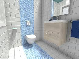 small bathroom with accent wall of blue mosaic tile