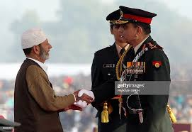 Indian Army Chief Deepak Kapoor shakes hands with Abdul Ahmad Bhat... News  Photo - Getty Images