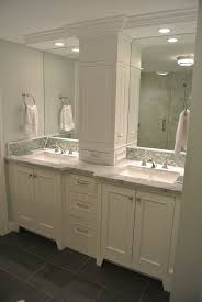 not this one but this arrangement double vanity w recessed tall cabinet bathroom recessed lightingbathroom