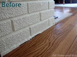there was just one item remaining the shoe molding to cover the gap where the brick and tile meets the wood floor