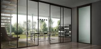 full exterior glass sliding door for open home office design with bookshelf vinyl floor tiles and high ceiling ideas