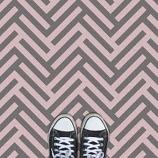 pink and grey herringbone parquet style vinyl flooring from forthefloorandmore com