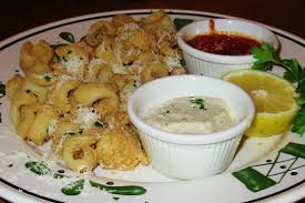tender calamari lightly breaded and fried with parmesan peppercorn and marinara sauces