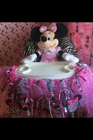 minnie mouse high chair decorations made from tule and ribbion also used a minie mouse cricket