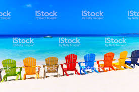 adirondack chairs on beach. Adirondack Chairs On Beach. Contemplation: Tropical Beach With Colorful  And Speedboat -