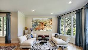 image of area rug over carpet in living room