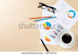 office table tops. Office Desk Workplace With Coffee Cup And Charts On Wooden Table. Top View Copy Table Tops