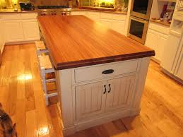 large modern white kitchen island with drawer and butcher block laminate island with seating plus white cabinet and vinyl floor tiles ideas