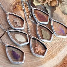 artist encases delicate beauty of nature in tiffany glass style pendant necklaces