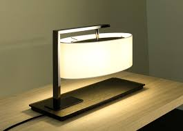 the luxurious kira table lamp by top contemporary lighting brand contardi lighting is modern yet classic with an oval shade black nickel arm bronze