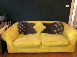 funky green sofa with polka dot round pillows and a green one
