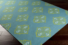 turquoise outdoor rug and green