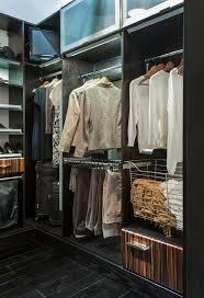 Wellborn Closets Door style: Palermo Finish: Macassar