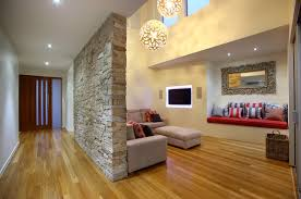 Inspiration for a contemporary medium tone wood floor living room remodel  in Brisbane with beige walls