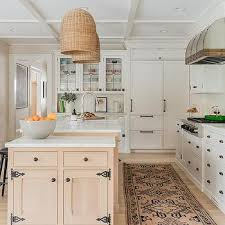light stained kitchen island with vintage iron latch hooks