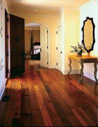 Reclaimed boards of varied tones call to mind the late 19th-century  practice of alternating