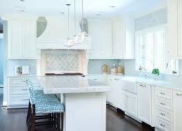 light blue quartz countertops white quartz stainless steel oven and blue and white kitchen tiles light blue quartz countertops