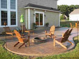 A Cobblestone Patio And In Ground Fire Pit Are Winners Is Our Book Average Price To Install A Patio Is 2 600 Cobblestone Patio Concrete Fire Pit Patio Patio