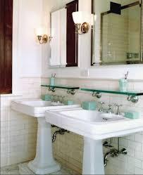small bathroom two pedestal sinks