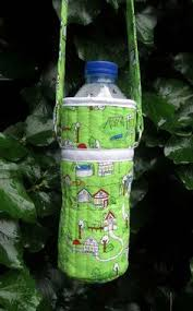 Wonderful DIY Water Bottle Holder   Sewing projects, Sewing ... & How to make a water bottle carrier. Easy and quick to make. The quilted  outer keeps your water cool and the strap makes it easy to carry. Adamdwight.com