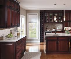 Dark cherry kitchen cabinets with glass cabinet doors by Decora Cabinetry  ...