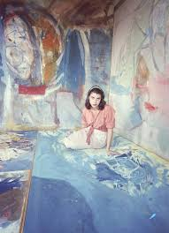 jewish american abstract expressionist painter and artist helen frankenthaler photographed sitting amidst her art in her