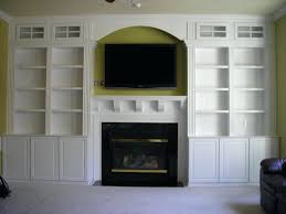 modern white wooden bookshelves fireplace combined wall mounted mounting flat screen tv stone gas over smlf