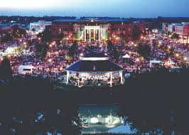 Aerial view of the gazebo and town square decorated in lights and red,  white,
